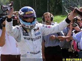 Mika Hakkinen celebrates taking pole position, today