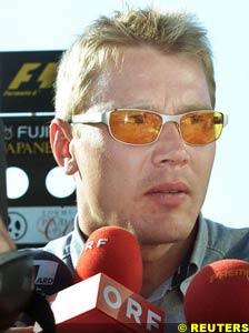 Hakkinen faces the press
