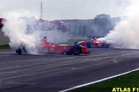 Barrichello and Schumacher burn rubber