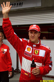 Michael Schumacher celebrates his 30th pole
