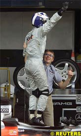 David Coulthard celebrates his victory, with teammate Hakkinen
