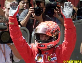 Schumacher celebrates after taking pole, today