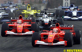 Schumacher leads at the start of the race