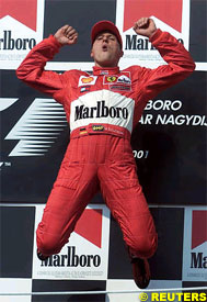 Michael Schumacher celebrates his win, today