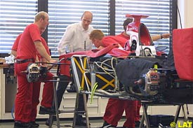 Toyota mechanics work on the car in Cologne