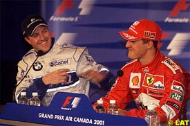 Ralf and Michael Schumacher laugh during today's press conference