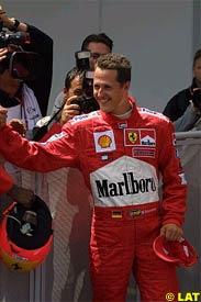 Michael Schumacher celebrates his pole, today