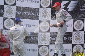 David Coulthard sprays champagne after the race