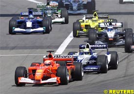Michael Schumacher leads brother Ralf at the start of the race