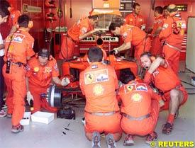 Ferrari mechanics working on Schumacher's car