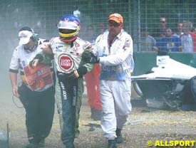 Villeneuve being aided away from his wrecked car