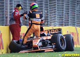 Bernoldi helped out of the car as he retires from the race, today