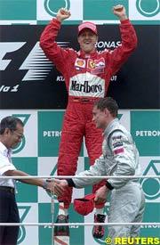 Michael Schumacher celebrates today's victory