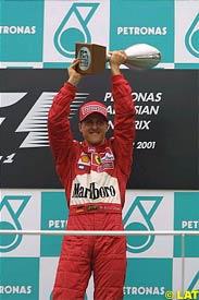 Michael Schumacher celebrates his 46th win