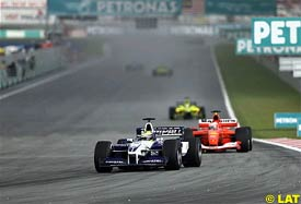 Ralf Schumacher leads Rubens Barrichello, today