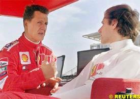 Michael Schumacher talks to Luca Badoer, today