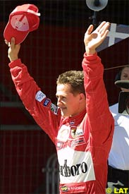 Schumacher celebrates his pole position, today