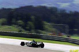 Eddie Irvine in action during qualifying