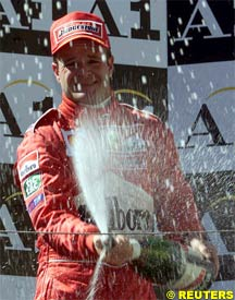 Barrichello sprays champagne after the race