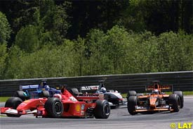 Verstappen, on the right, after the start of the race