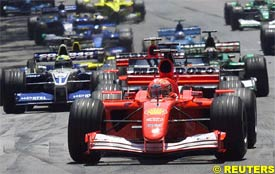 Michael Schumacher leads at the start of the race, today